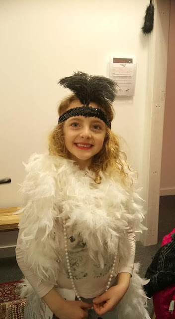 Molly dressed up for the mafia room with feathers and pearls.