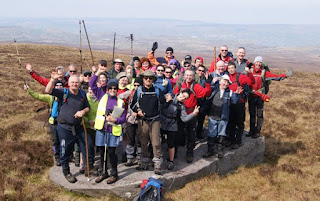 group of hill walkers cheering on cuilcagh mountain top