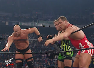 WWE / WWF Survivor Series 2001 - Steve Austin, RVD, and Kurt Angle reach for a tag
