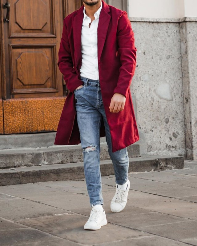 Burgundy overcoat and blue jeans