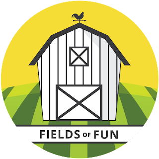 Fields of Fun logo featuring a black and white barn on a background with a golden sky and a green striped field
