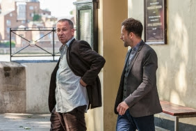 Sean Pertwee as Gareth Lestrade and Jonny Lee Miller as Sherlock Holmes in CBS Elementary Season 2