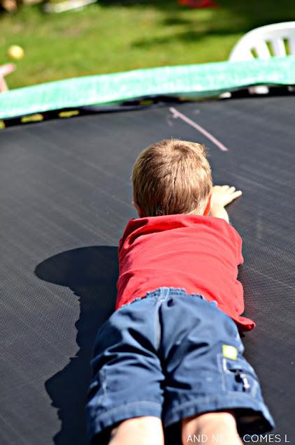 Clock activity for kids using sidewalk chalk on the trampoline