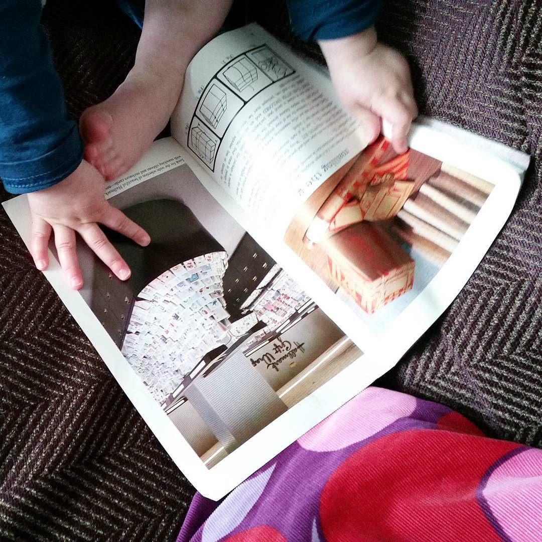 This Little Big Life: Toddler reading vintage brochure