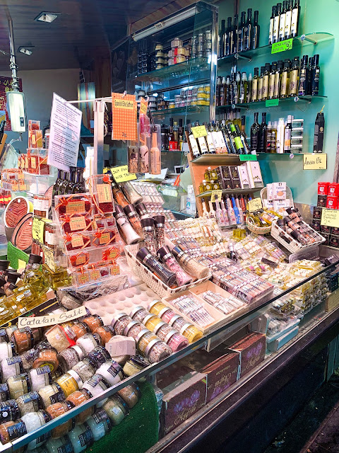 Mark stall with different local products such as dried fruit, cheese