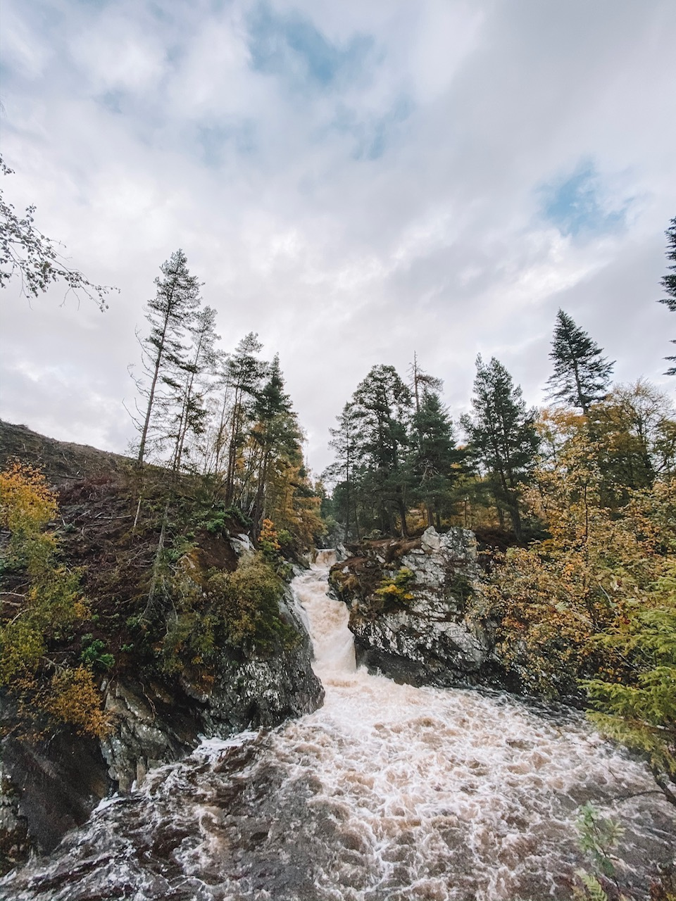 Lifestyle blogger Amanda Martin of Amanda's OK Blog hikes the Falls of Bruar in Scotland