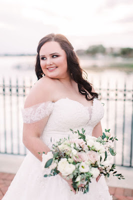 Beautiful bride in wedding dress and pink bouquet