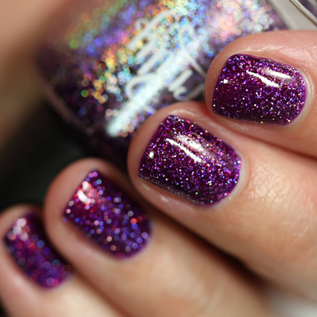 purple nail polish with holographic glitter and shimmer