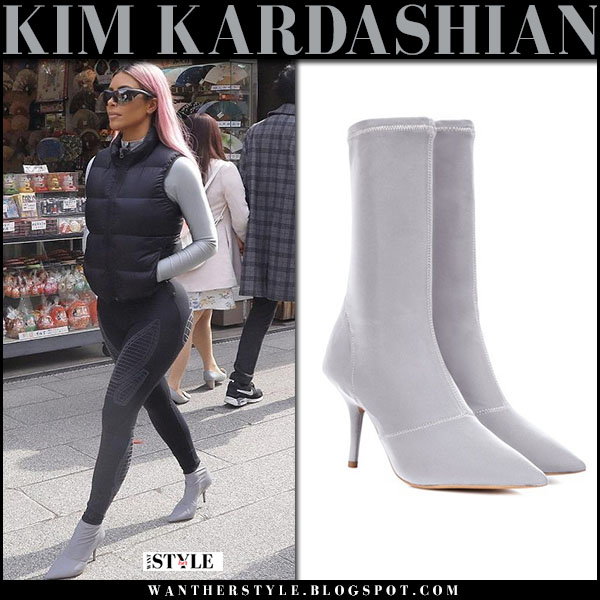 Kim Kardashian in light grey ankle sock boots yeezy and black leggings street fashion march 1