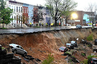 A street in Baltimore, one of the cities suing Big Oil over climate change, partially collapsed in 2014 in heavy rainfall during one of the city's wettest Aprils on record. Scientific studies warn to expect more extreme precipitation as the planet warms. (Credit: Jonathan Newton/Washington Post via Getty Images) Click to Enlarge.