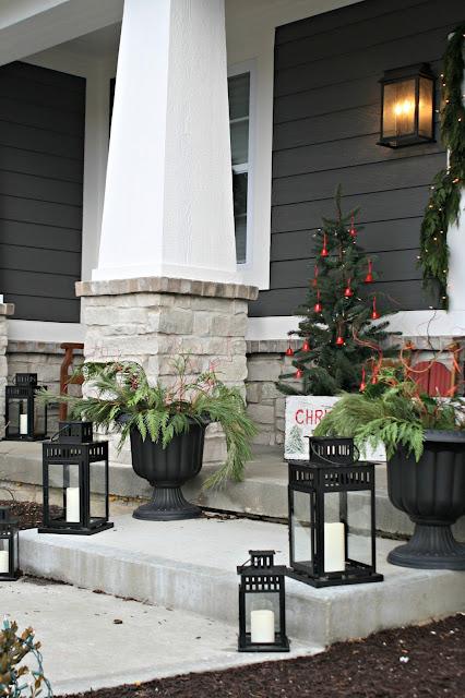 Black lanterns on porch