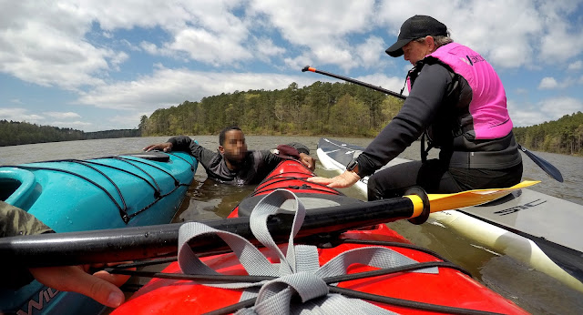 rescuing swimmer with kayak