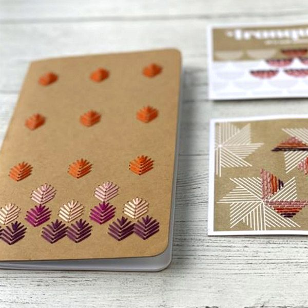 kraft paper notebook with stitching on cover and stitched kraft cards