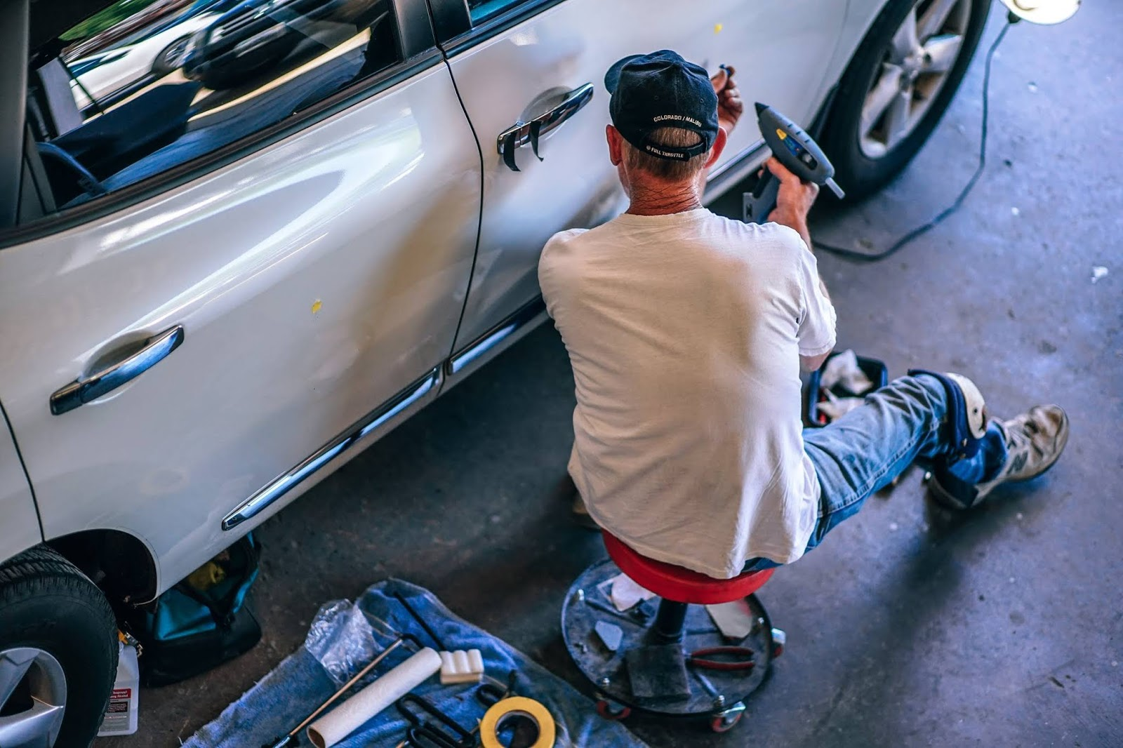 mechanic fixing a car at a garage