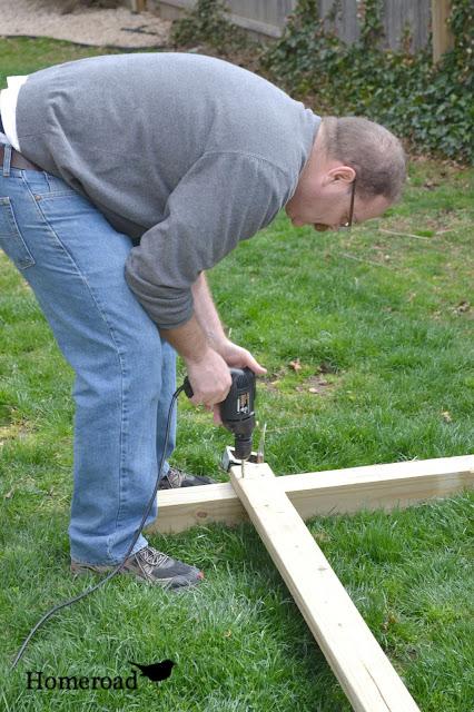 Man drilling boards together
