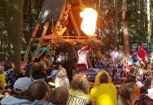 Professor Pumpernickel's science tricks exploding cornflour with huge burst of flame above crowd