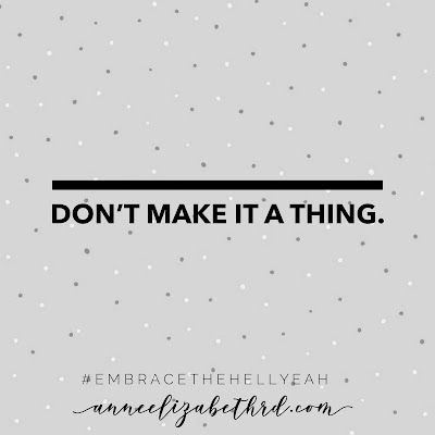 Inspirational Quote in black letters on grey background with white polka dots