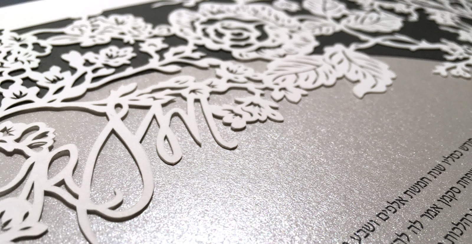 Handmade papercut by Naomi Shiek features delicate flowers and blooms such as Cherry Blossom branches, Roses, and Daisies. Also features a custom monogram