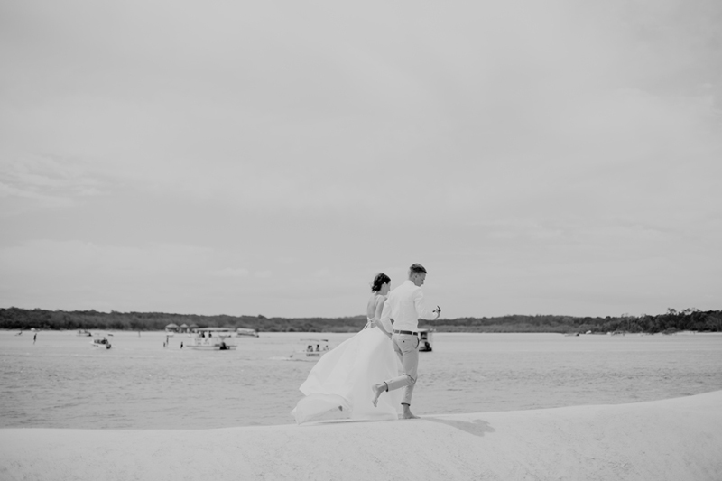 shot of wedding couple running
