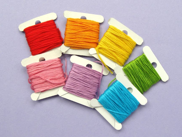 Rainbow embroidery threads to decorate a denim jacket