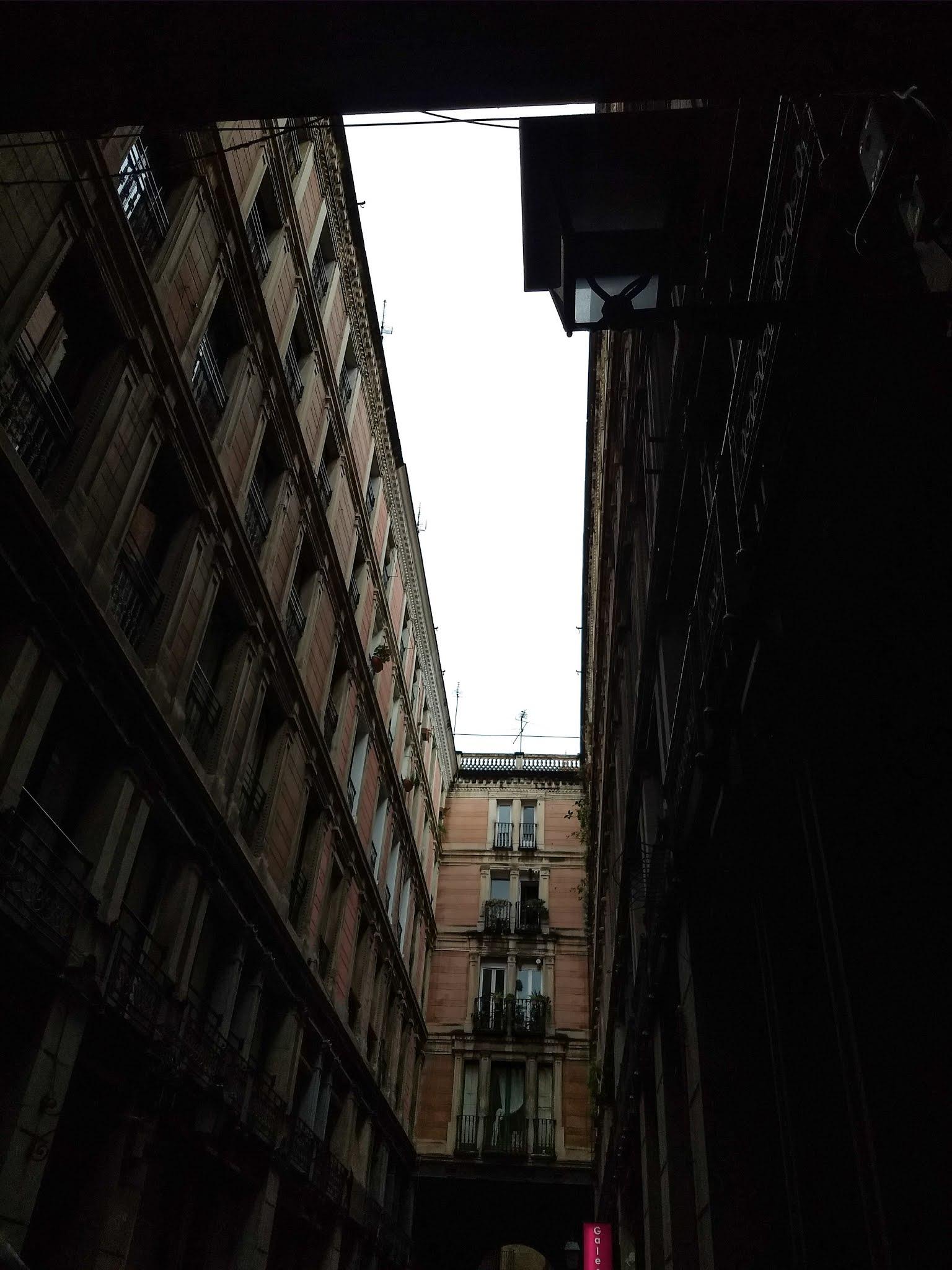 Building passageway on Carrer d'en Rauric in Barcelona, Spain.