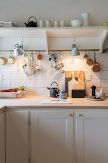 Open white shelving in a European farmhouse style kitchen on Hello Lovely Studio