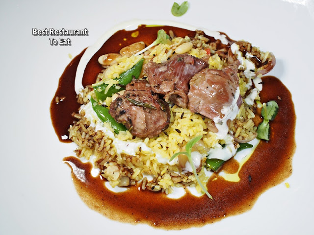 Chef Marcin Budynek Slow-Roasted Lamb Shoulder with Vegetable Pilaf