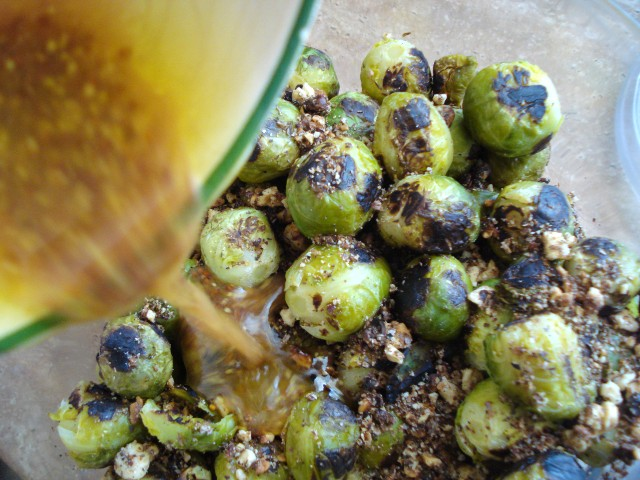 Pour the vinegar dressing over the sprouts