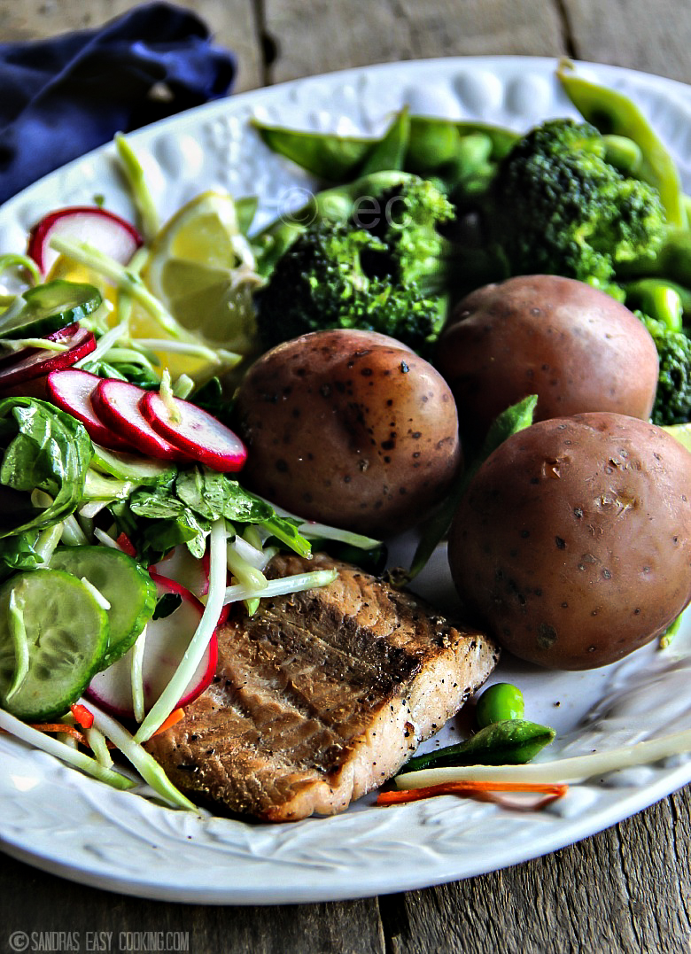 Steamed edamame & broccoli with salad over pan seared salmon and boiled new potatoes