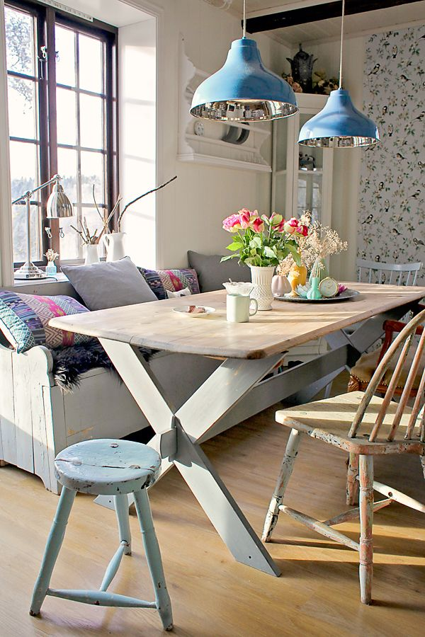 relaxed cottage inspired dining area with rustic furniture and blue accents