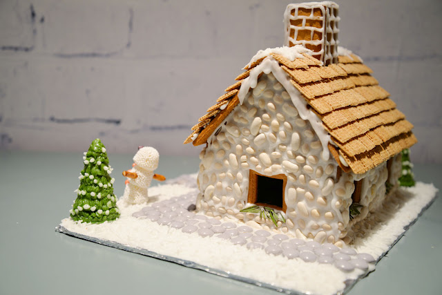 english cottage gingerbread house | navy kidney bean stone walls | RamblingRenovators.ca