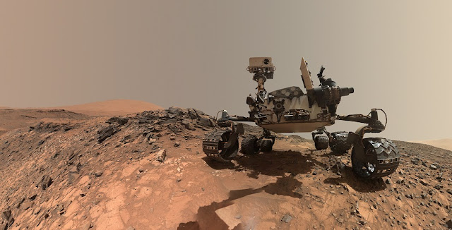 "This low-angle self-portrait of NASA's Curiosity Mars rover shows the vehicle at the site from which it reached down to drill into a rock target called ""Buckskin."" The MAHLI camera on Curiosity's robotic arm took multiple images on Aug. 5, 2015, that were stitched together into this selfie. Photo Credit: NASA/JPL-Caltech/MSSS"