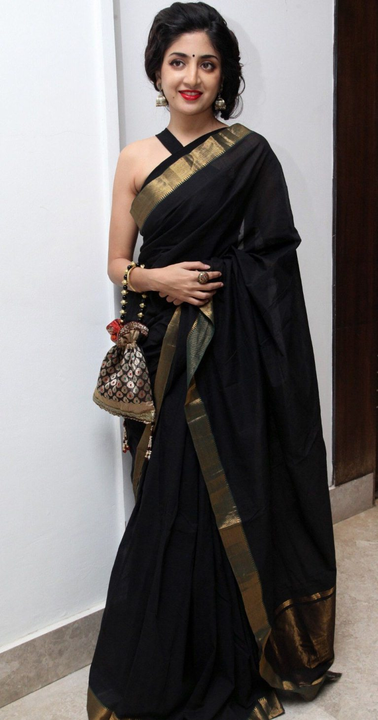 Tollywood Actress Stills In Sleeveless Black Saree Poonam Kaur