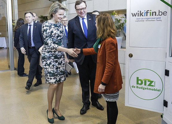 Queen Mathilde gave a speech about financial education and the sustainable development goals at the NYSE Euronext Brussels Stock Exchange in Brussels. Queen wore natan dress
