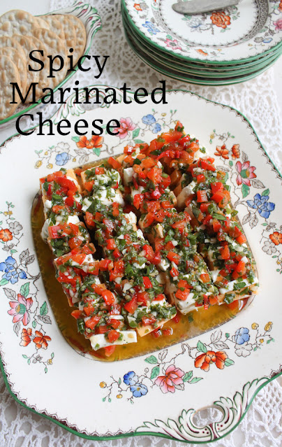 Food Lust People Love: Spicy marinated cheese is not just pretty, it's also delicious! It's the perfect party food for the cheese lovers in your life.