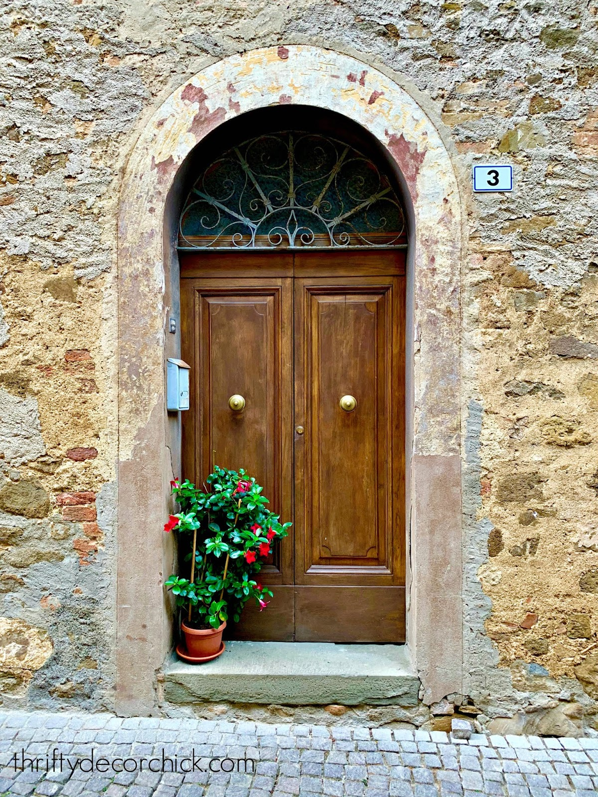 Rounded wood doorway in Italy