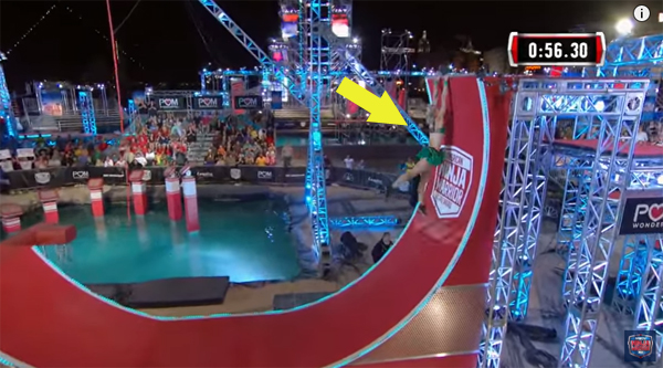 image of Jessie reaching for the top of the Warped Wall