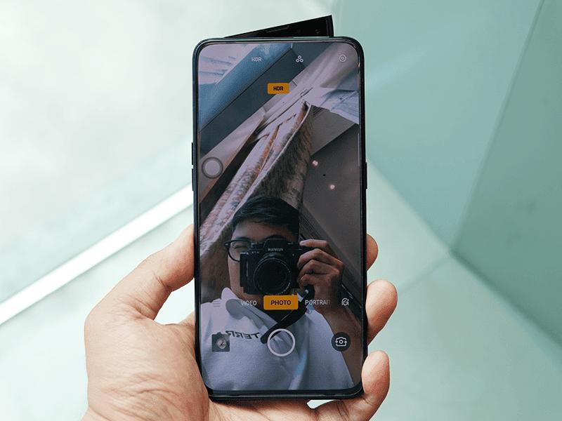 Shark fin-like pop-up camera design