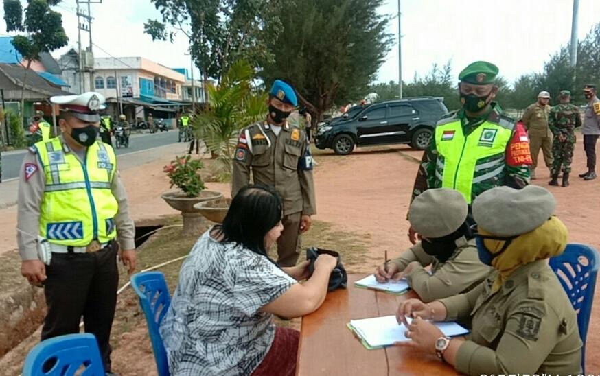 Kapolres Natuna Pimpin Apel Operasi Yustisi Penegakan Perbup No 51 Tahun 2020