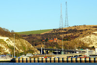 Two masts of Second World War Swingate Chain Home Radar Station, ex-RAF Swingate, now Swingate Transmitting Station. Also: Coastguard Cottages, Broadlees Bottom, A2 Jubilee Way bypass, White Cliffs of Dover, Eastern Docks, Dover harbour from Prince of Wales pier.