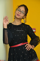 Aditi Myakal in Spicy Red Short Skirt and Transparent Black Top at at Big FM For Promotion of Movie Ami Tumi 032.JPG