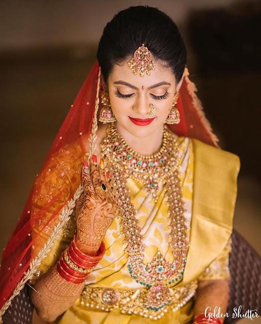 Bride in Kundan Patakam Haram Jumbo jhumkas