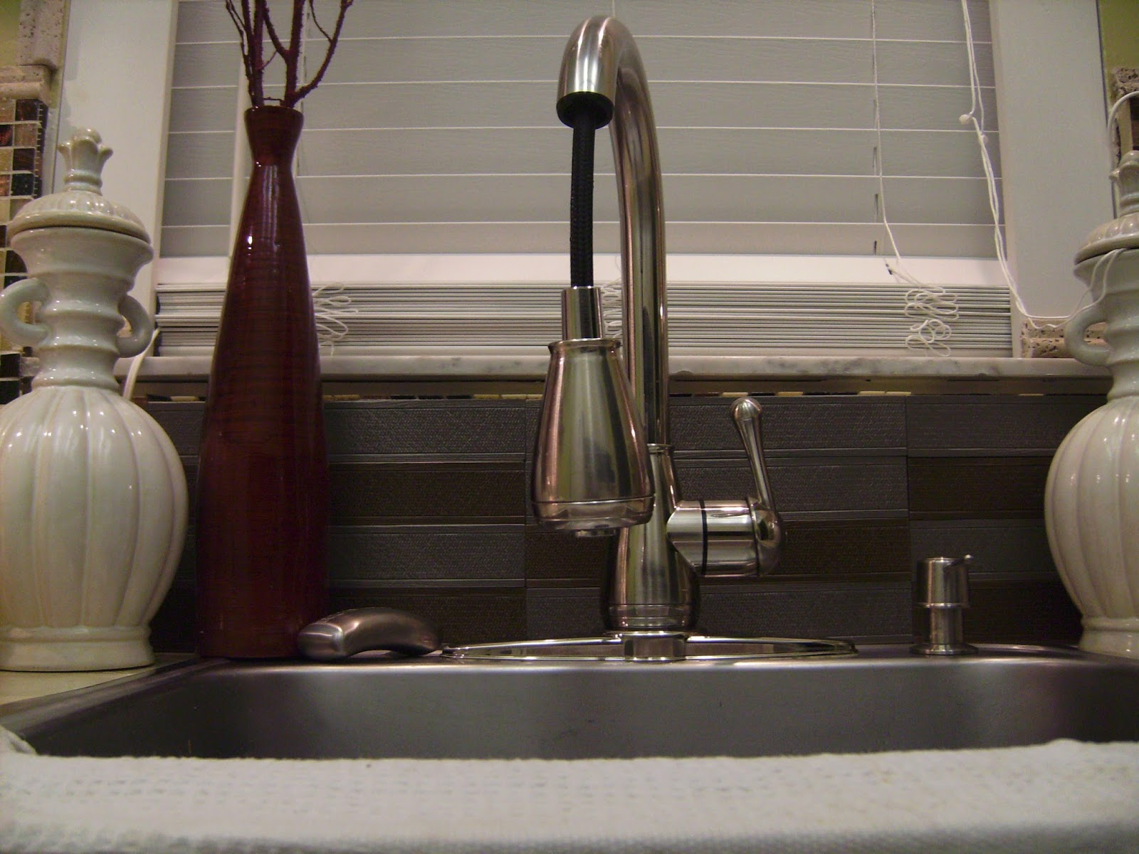 How to Remodel and Decorate a Small Kitchen. Adding decorative tile back splash.