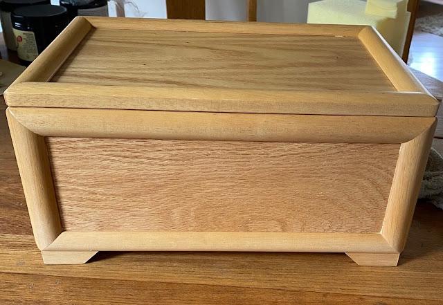 Photo of a plain light oak jewelry box