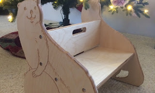 wood chair for children with otters carved on sides