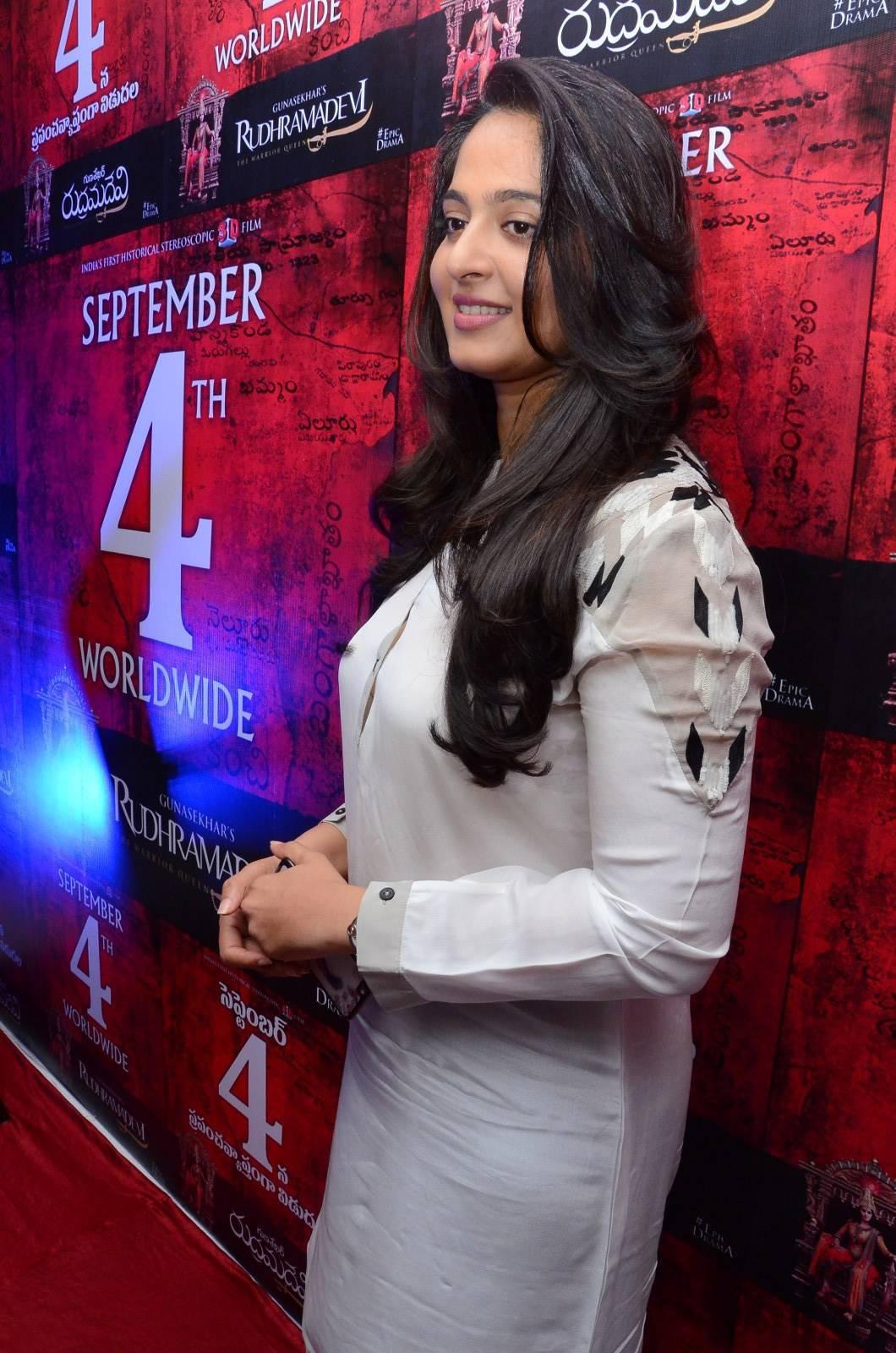 Anushka Shetty Stills In White Dress At Telugu Movie Press Meet