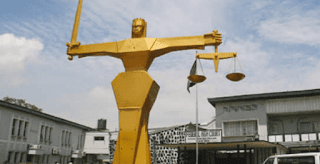 """Court sentences """"Yahoo Yahoo"""" mother and son to three years for N27M fraud"""