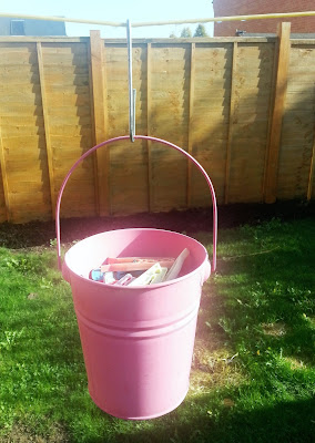 Pink Peg Bucket Hanging from Washing Line