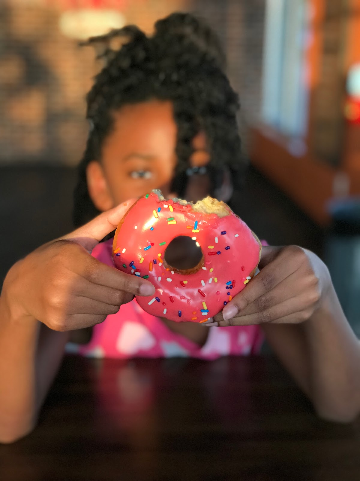 Image: Moriah holding Donut at Hurts in Frisco Texas. Seen first on Bits and Babbles Blog