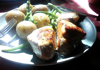 Pork medallions with boiled spuds and green beans in butter